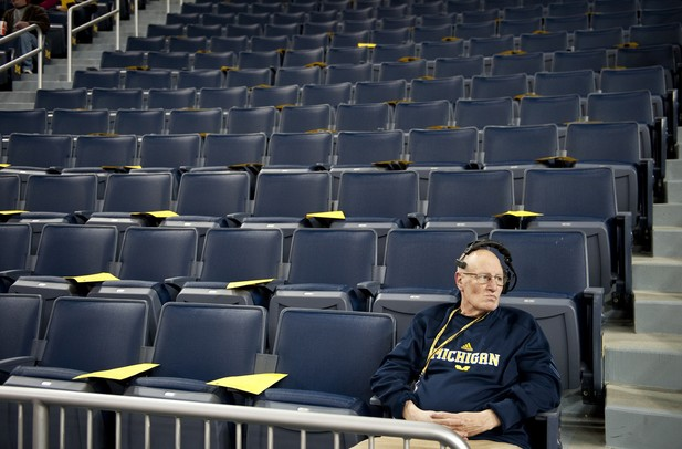 Audio tech Tim Ofarrelo sits in an empty seating section before the game between Michigan and Binghamton on Tuesday. Daniel Brenner I AnnArbor.com