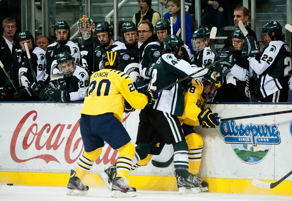 Michigan State senior kevin Walrod checks Michigan freshman right wingman Andrew Copp in the first period on Friday. Daniel Brenner I AnnArbor.com