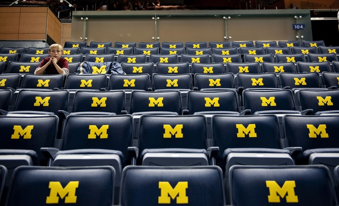 Patrick Bertoni, 12, waits for his dad before the Michigan game against Saginaw Valley State on Monday. Daniel Brenner I AnnArbor.com