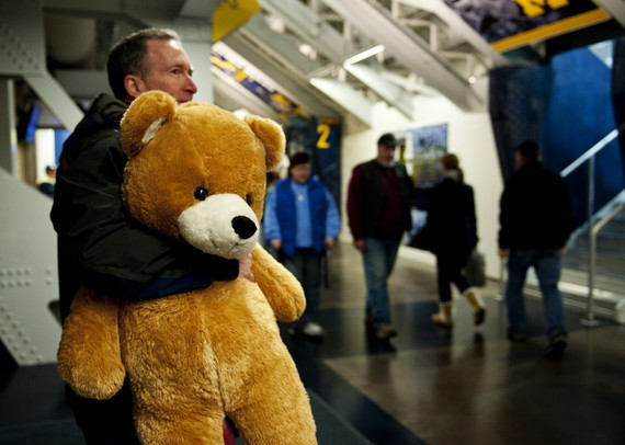 "Michigan season ticket holder of 18 years Tom Berrodin holds a teddy bear before the game against Western Michigan on Saturday. ""I've brought bigger,"" he says. Daniel Brenner I AnnArbor.com"