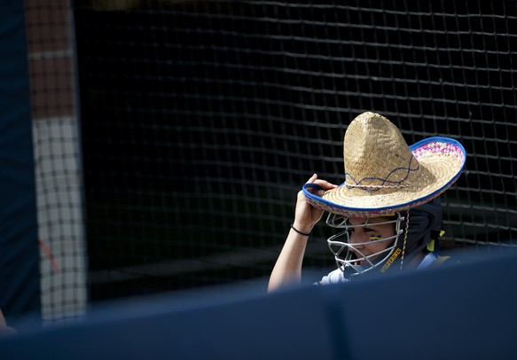 Michigan catcher Lauren Sweet wears a sombrero before the game against Northwestern on Sunday, May 5. Daniel Brenner I AnnArbor.com