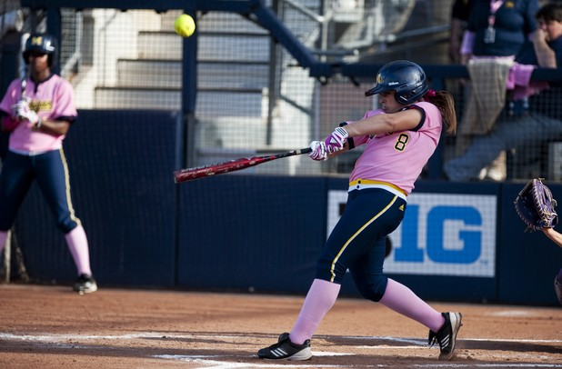 Michigan second baseman Ashley Lane makes contact with a ball in the game against Northwestern on Friday, May 3. Daniel Brenner I AnnArbor.com