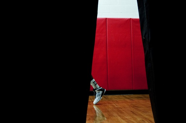 An Ypsilanti High School basketball player walks toward the court before the game against Saginaw High on Tuesday, March 19. Daniel Brenner I AnnArbor.com