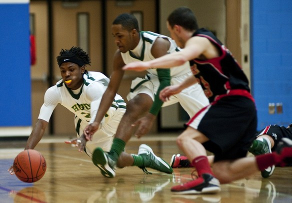 Huron High School senior Demetrius Sims dives for a loose ball in the game against Pickney on Monday, March 4. Daniel Brenner I AnnArbor.com