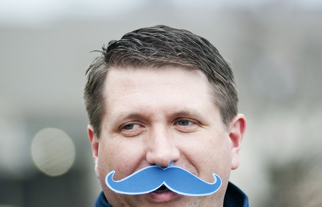 Ann Arbor resident and season ticket holder Kelly Cox wears a fake mustache for Movember men's health awareness month on Saturday. Daniel Brenner I AnnArbor.com