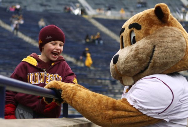 Will Harder,6, has a laugh with Minnesota's mascot, Goldy, as Michigan took on the University of Minnesota Saturday October 1, 2011. Jeff Sainlar I AnnArbor.com