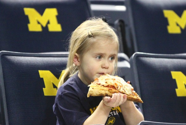 Thora Crawford enjoys a slice of pizza as Michigan took on Ferris State at the Crisler Arena Friday November 11, 2011.Michigan won the game 59-33. (AP Photo/AnnArbor.com, Jeff Sainlar I AnnArbor.com)