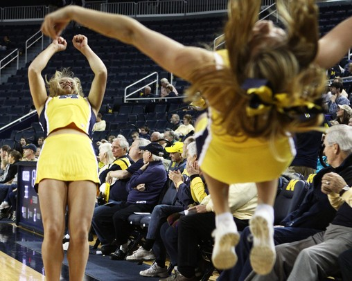 Michigan cheerleaders do backflips as the University of Michigan men's basketball team took on Western Illinois Thursday November 17, 2011 at the Crisler Arena. Michigan won the game 59-55. Jeff Sainlar I AnnArbor.com