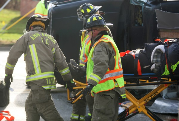 The Ann Arbor Fire Department was called in to help free a man who was pinned inside as his truck overturned at Jackson St. and Maple Rd. on Friday November 18, 2011. Jeff Sainlar I AnnArbor.com