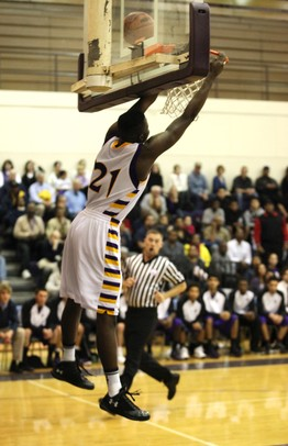 Ypsilanti's Mamadou Ba misses a break away dunk as Ann Arbor Pioneer took on Ypsilanti Friday December 9, 2011 at Ypsilanti High School. Ypsilanti won the game convincingly 70-38. Jeff Sainlar I AnnArbor.com