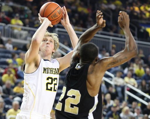 Images from the Michigan basketbal team's 63-50 win ...