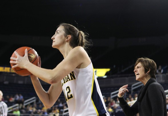 Michigan's Kate Thompson spots up for a three-point shot in front of Indiana State head coach Teri Moren as Michigan women's basketball team took on Indiana St Saturday December 17, 2011. Michigan won the game 72-44. Jeff Sainlar I AnnArbor.com